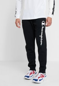 Champion - CUFF PANTS - Verryttelyhousut - black - 0