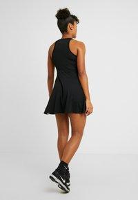 Nike Performance - DRY DRESS - Sports dress - black/white - 2