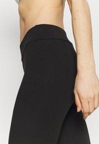 Puma - LEGGINGS - Collants - black/silver - 3