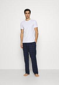 Calvin Klein Underwear - SLEEP PANT - Pyjama bottoms - blue - 1