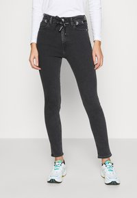 Calvin Klein Jeans - HIGH RISE SKINNY - Jeans Skinny Fit - black with eyelet - 0