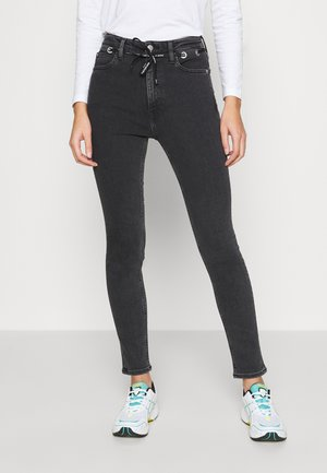 HIGH RISE SKINNY - Jeans Skinny - black with eyelet