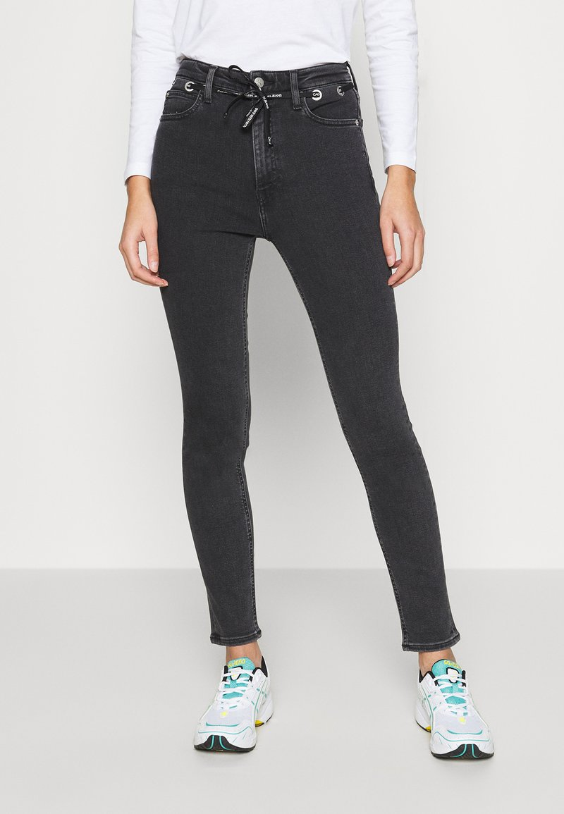 Calvin Klein Jeans - HIGH RISE SKINNY - Jeans Skinny Fit - black with eyelet