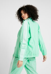 adidas Originals - ADICOLOR SPORT INSPIRED NYLON JACKET - Větrovka - prism mint/white - 2