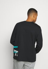 Puma - FRANCHISE STREET TEE - Long sleeved top - black - 2