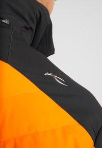 Kjus - MEN SIGHT LINE JACKET - Ski jacket - black/orange - 8
