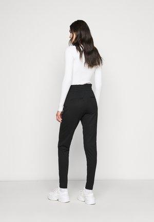 ONLPOPTRASH EASY FRILL PANT - Tracksuit bottoms - black
