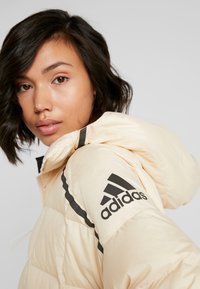 adidas Performance - Z.N.E. DOWN JACKET - Winter jacket - sand - 4