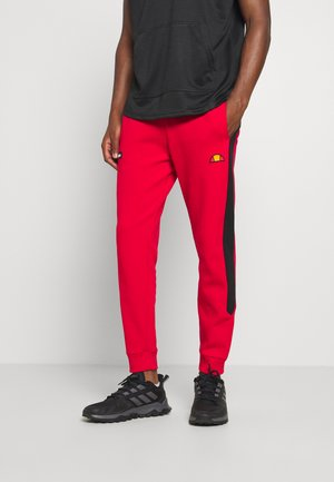 POTAT - Tracksuit bottoms - red