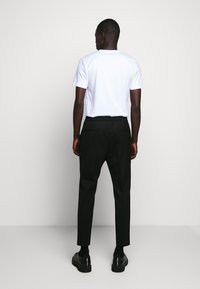 HUGO - HARLYS - Trousers - black - 2