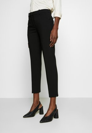 PERFEKT - Trousers - black