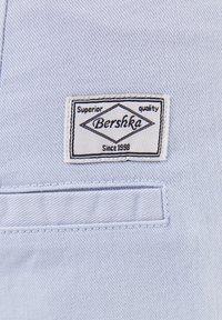 Bershka - Trousers - light blue - 4