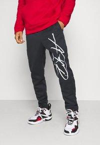Jordan - AIR THERMA PANT - Teplákové kalhoty - black/white - 0