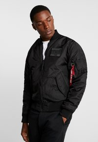 Alpha Industries - REVERSIBLE TEDDY - Bomberjacks - black - 4