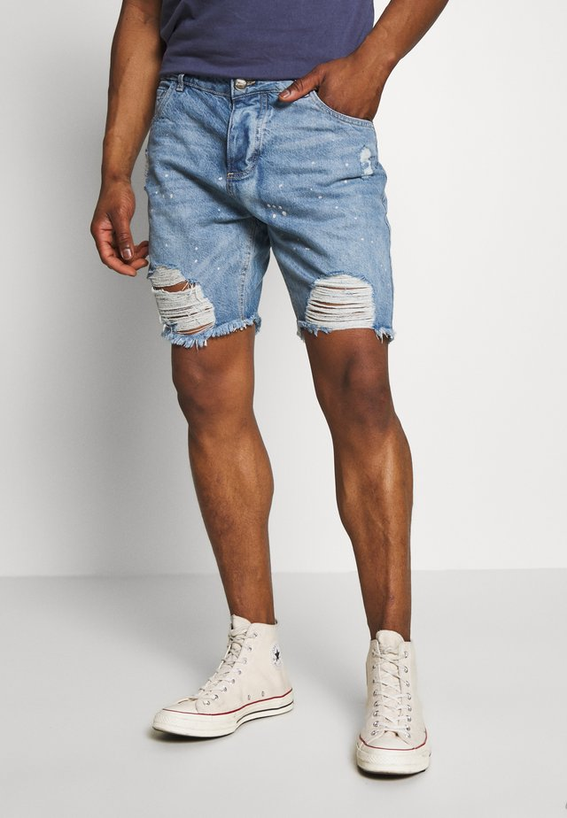 RIPPED SHORTS - Farkkushortsit - blue