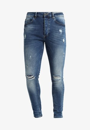 DISTRESSED - Skinny džíny - mid wash blue