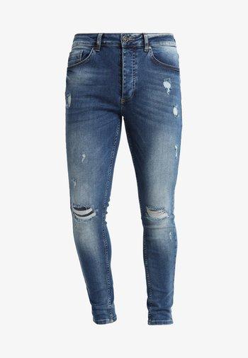DISTRESSED - Jeans Skinny Fit - mid wash blue