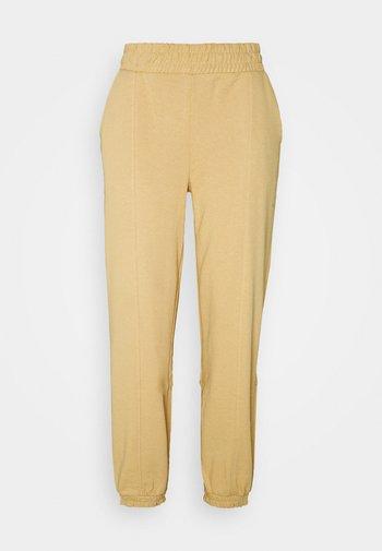 ONLDEA DETAIL PANTS  - Tracksuit bottoms - warm sand