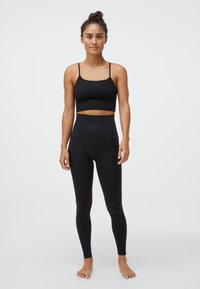 OYSHO - Light support sports bra - black - 1
