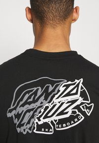 Santa Cruz - UNIVERSAL DOT UNISEX - T-shirt imprimé - black - 5