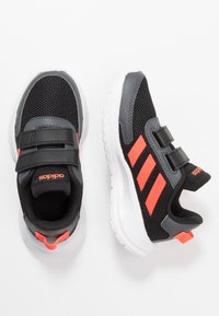 adidas Performance - TENSAUR RUN UNISEX - Neutral running shoes - core black/solar red/grey six - 0