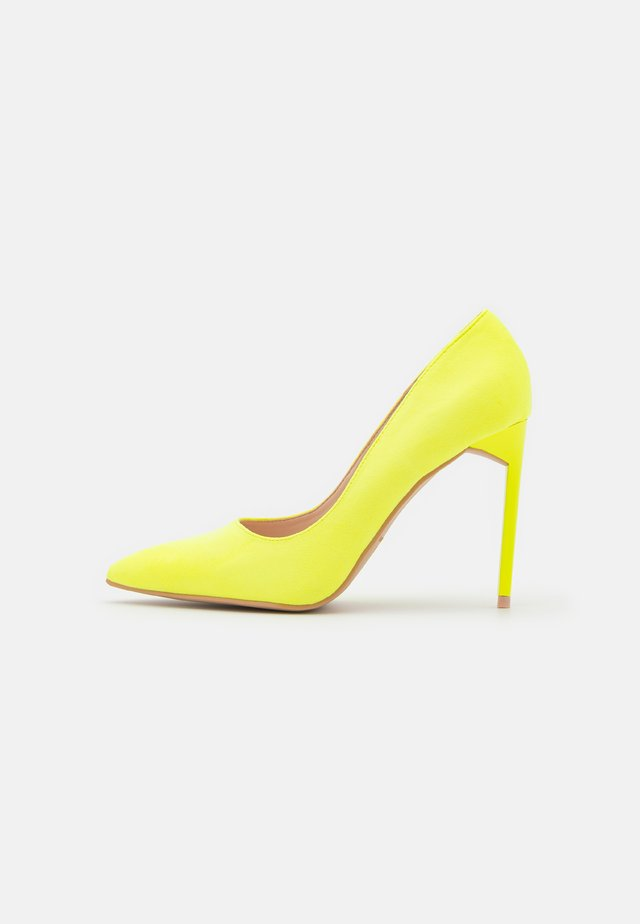 ANTIX - Højhælede pumps - yellow