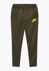 Nike Sportswear - TAPERED PANT - Tracksuit bottoms - cargo khaki/volt - 0