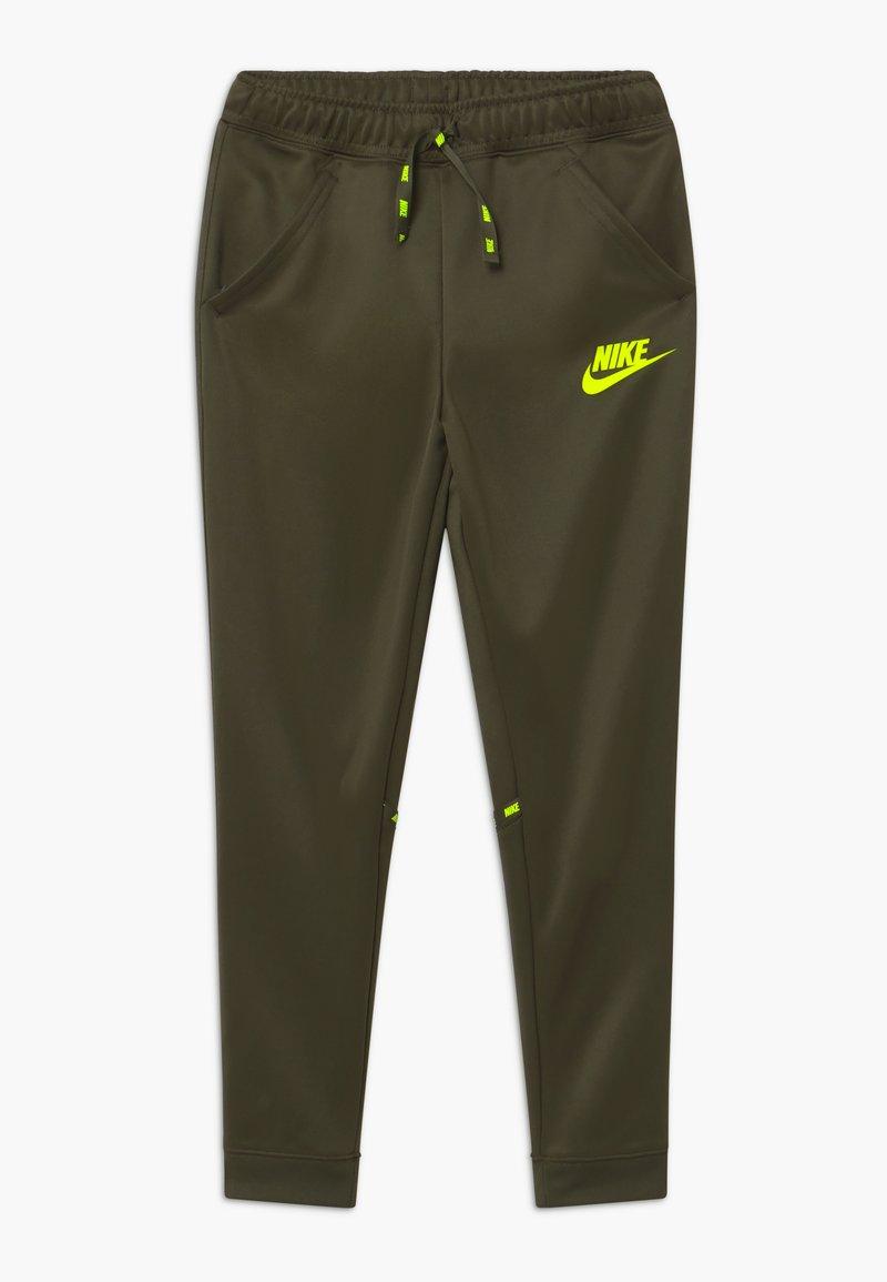 Nike Sportswear - TAPERED PANT - Tracksuit bottoms - cargo khaki/volt