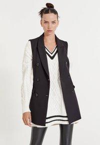 PULL&BEAR - LEICHTE - Waistcoat - mottled black - 0