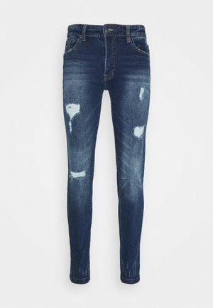MR RED - Jeans Skinny Fit - dark blue destroy
