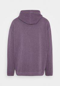 Karl Kani - SMALL SIGNATURE WASHED HOODIE UNISEX - Hoodie - purple - 1