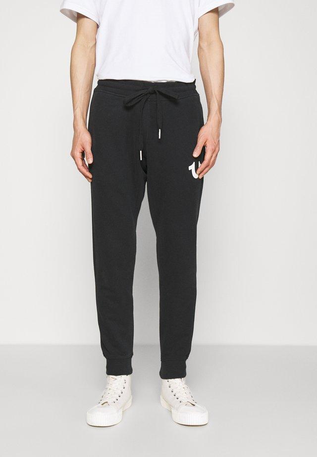 PANT CELESTIAL - Teplákové kalhoty - black
