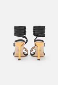 Stuart Weitzman - BEATRIX WRAP - Sandals - black/gold - 3