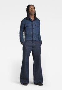 G-Star - GRIP 36 LOOSE - Flared Jeans - kara steel denim - raw denim - 1
