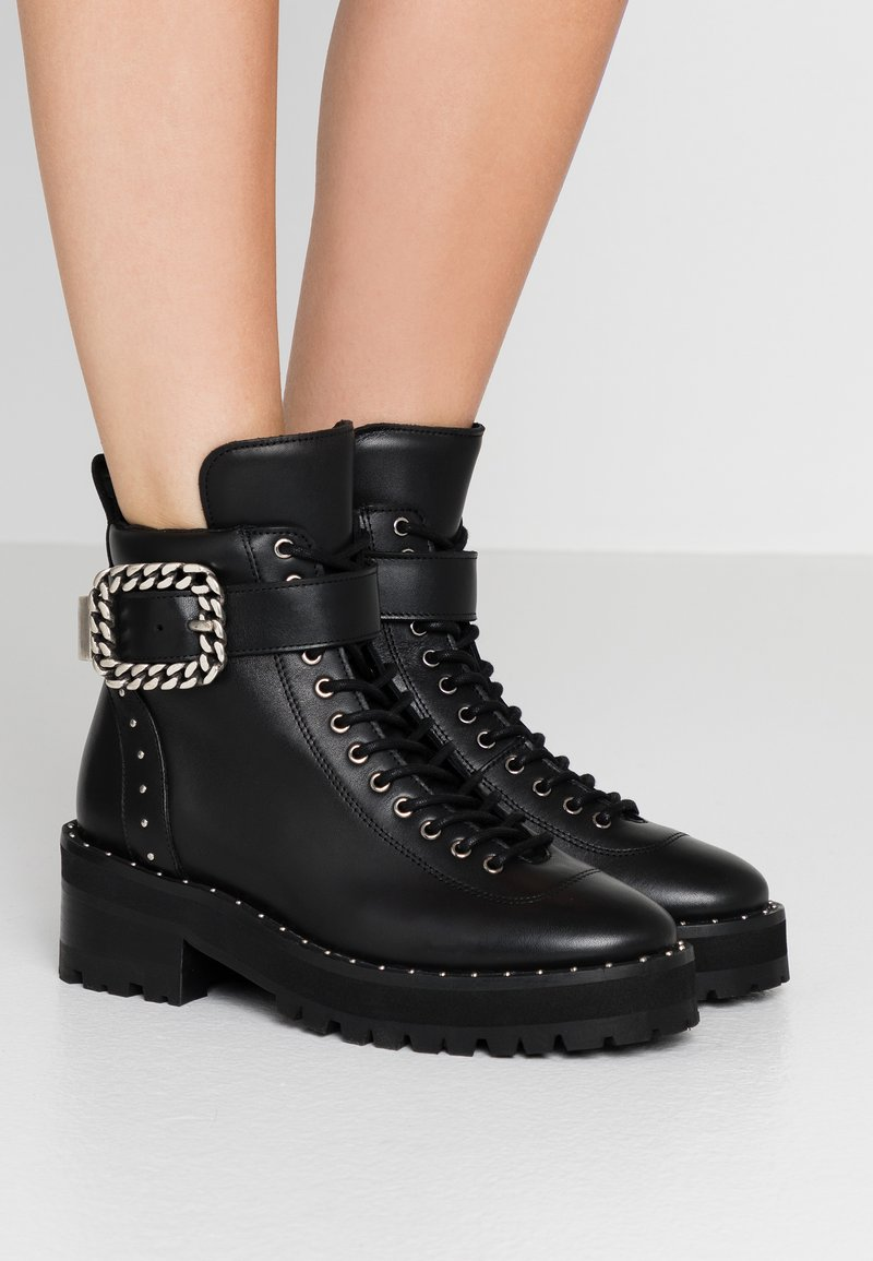 The Kooples - BUCKLE BOOT - Ankle boots - black/silver