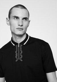 HUGO - DOLMAR - Polo shirt - black - 4