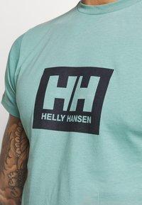 Helly Hansen - TOKYO - Print T-shirt - jade - 5