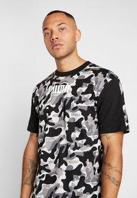 Puma - REBEL CAMO TEE - Print T-shirt - black - 4