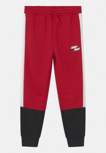 JUMPMAN - Tracksuit bottoms - gym red