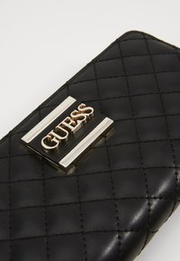 Guess - LARGE ZIP AROUND - Lommebok - black - 2