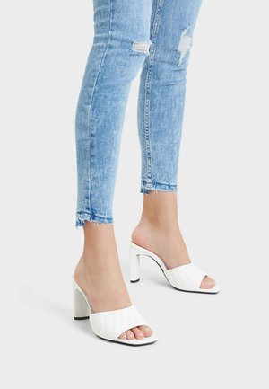 Heeled mules - white
