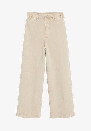 CARLOTA - Flared jeans - beige