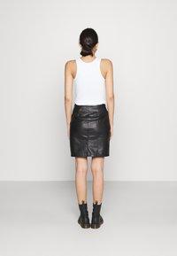 Vila - VIPEN BUTTON COATED SKIRT - Mini skirt - black - 2
