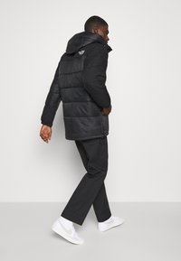 The North Face - HIMALAYAN INSULATED PARKA - Winter coat - black - 4