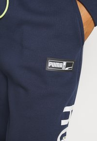 Puma - FRANCHISE - Tracksuit bottoms - peacoat - 4