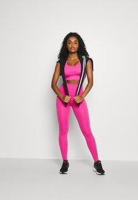 adidas Performance - DESIGNED4TRAINING FORMOTION COMPRESSION - Medium support sports bra - screaming pink - 1