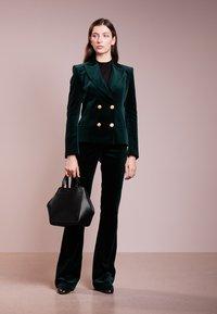 Filippa K - SHELBY MINI BUCKET  - Handbag - black - 1