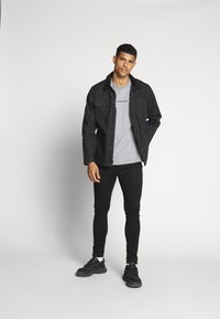 Calvin Klein Jeans - INSTIT CHEST TEE - T-shirts print - mid grey heather - 1
