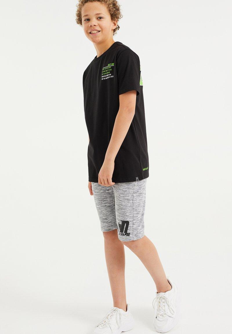 WE Fashion - T-shirt con stampa - black