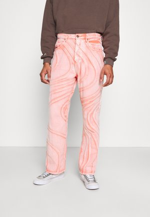 WASH WAVE SEAM - Relaxed fit jeans - orange